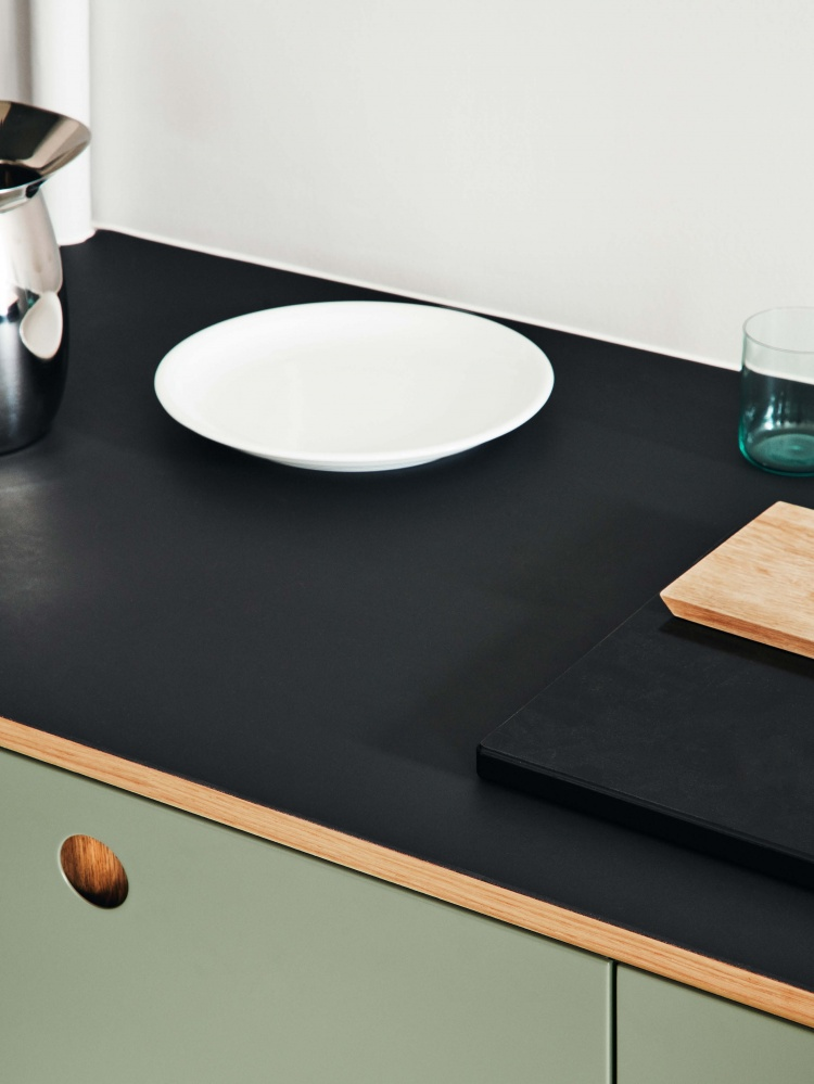 https://cdn-www.reformcph.com/Green painted Basis front and dark tabletop
