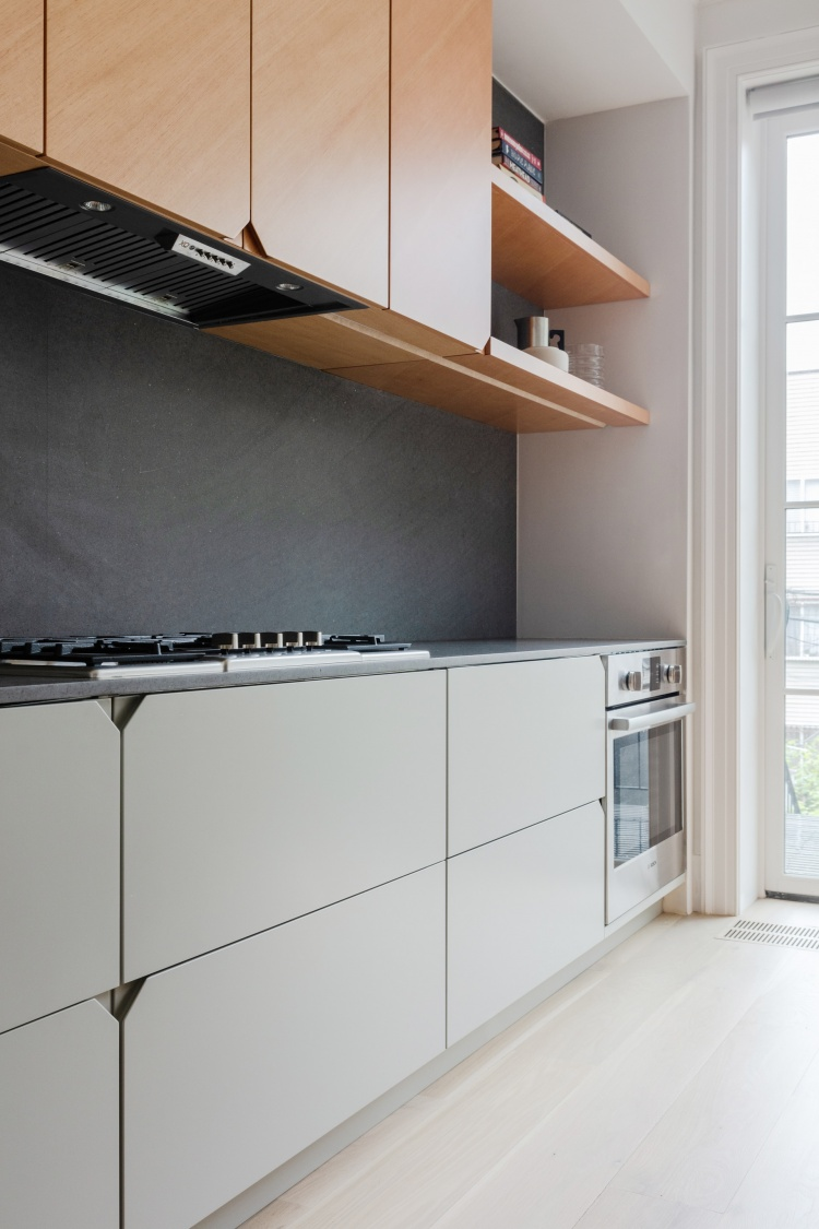 https://cdn-www.reformcph.com/White base cabinets and wall cabinets in wood